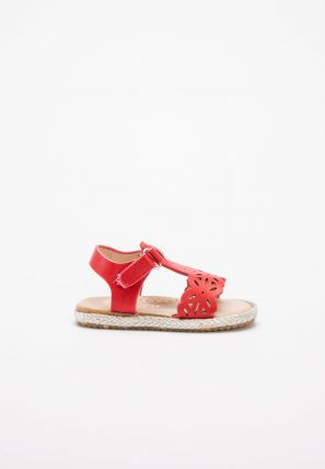 Popular sandal with a cut out geometrical design and Velcro closure
